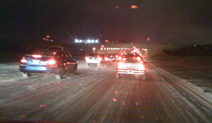 Snow and traffic on Murfreesboro Road entering the airport tunnel